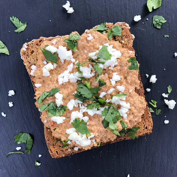 mexican pumpkin seed and roasted tomato dip on toast